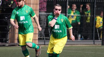 young footballer with downs' syndrome celebrates