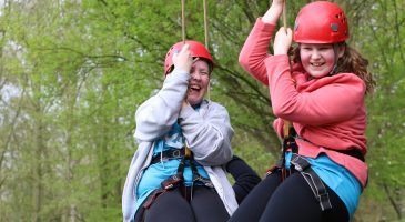 two girls on a zip line