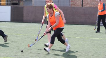 an extra time participant plays hockey