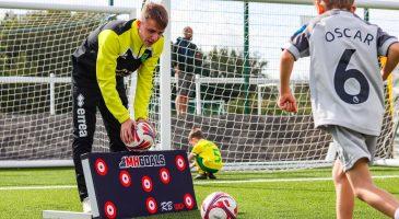 young footballer kicks a ball