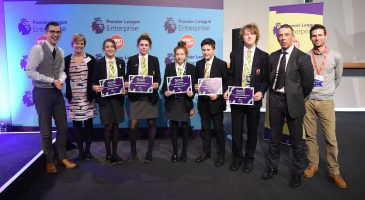 pupils show their certificates