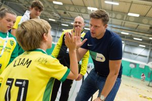 Jake Humphrey high fives a young player