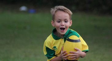 young boy with rugby ball