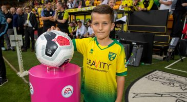 Brave young fundraiser welcomed to Carrow Road