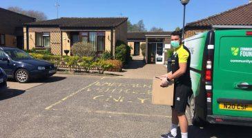 Staff deliver food parcels