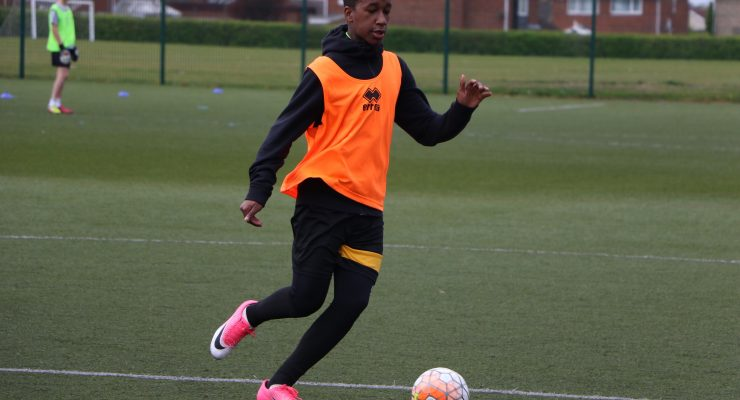 A young person playing football