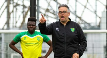 A coach in Norwich City kit takes a session