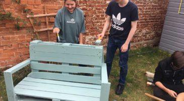 National Citizen Service participants paint furniture at The Nest