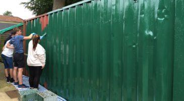 National Citizen Service participants paint at community centre