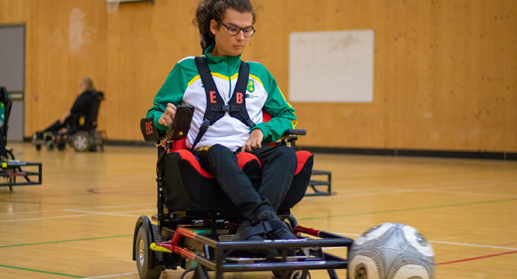 Powerchair player takes part in training